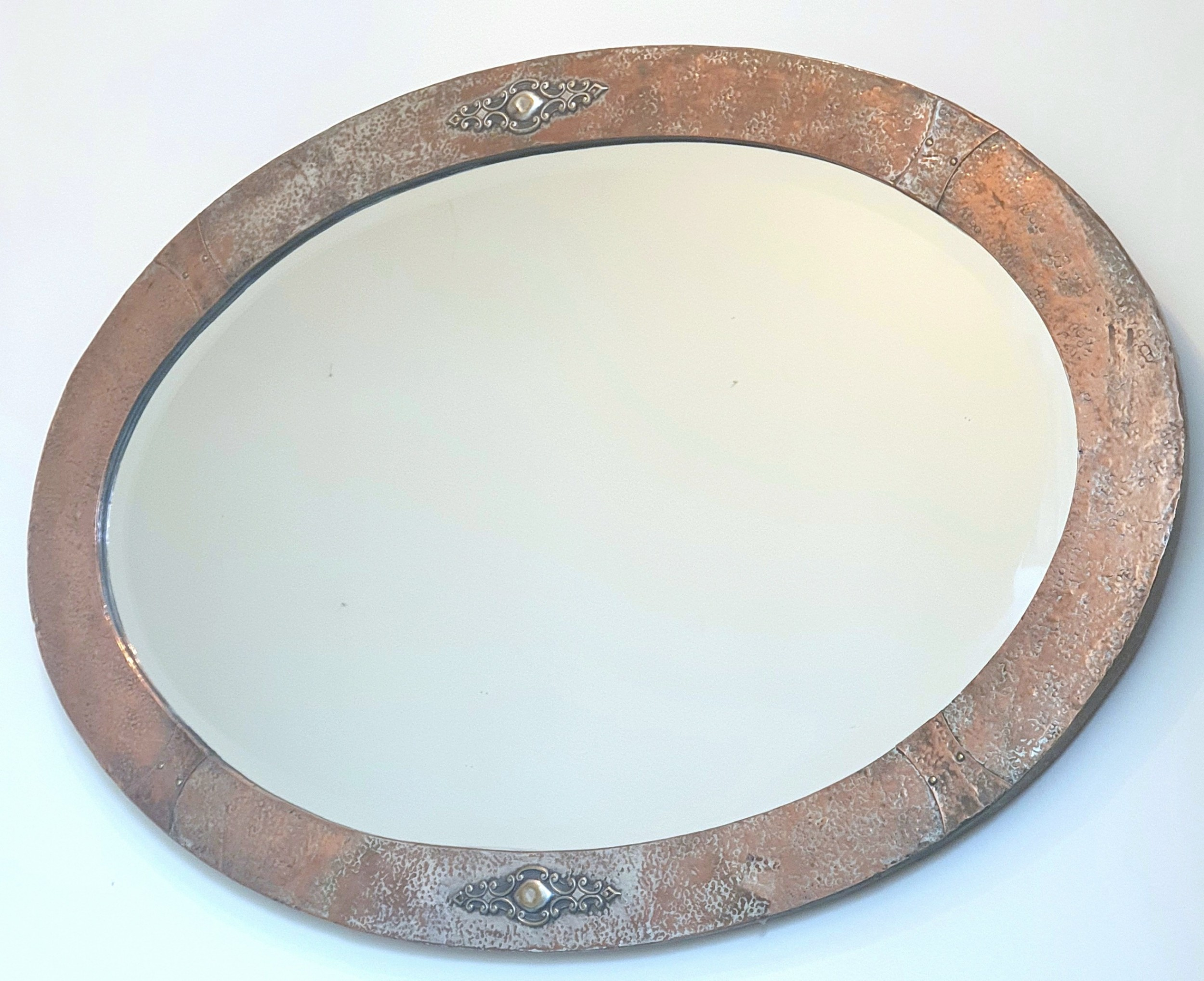arts crafts silver over bronze copper studded oval wall mirror with original wooden backing
