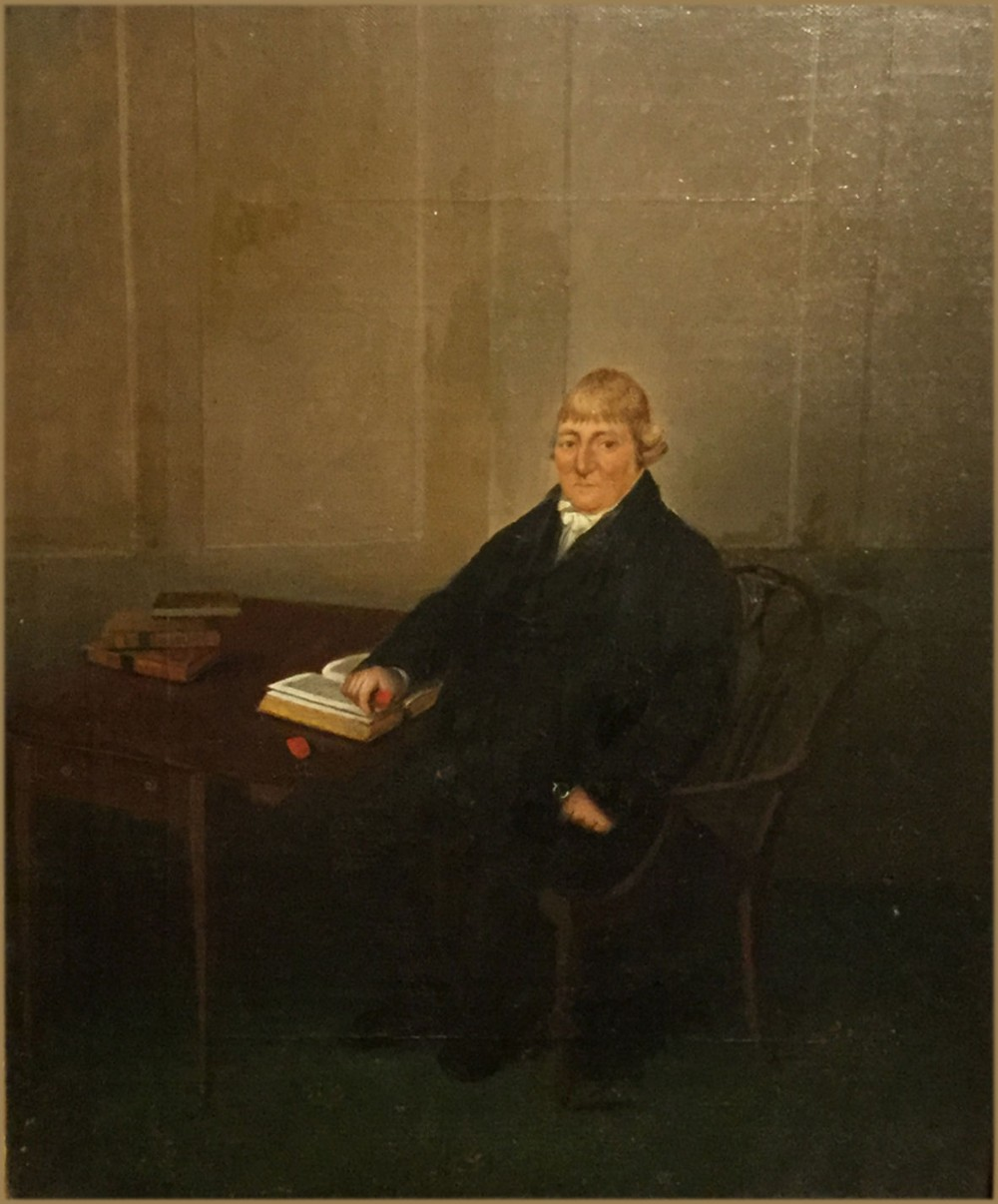 stephen taylor fl 1808 1849a gentleman seated on a chippendale desk chair in a paneled interior