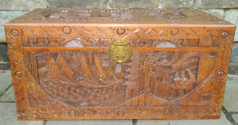 Carved oriental camphor wood trunk