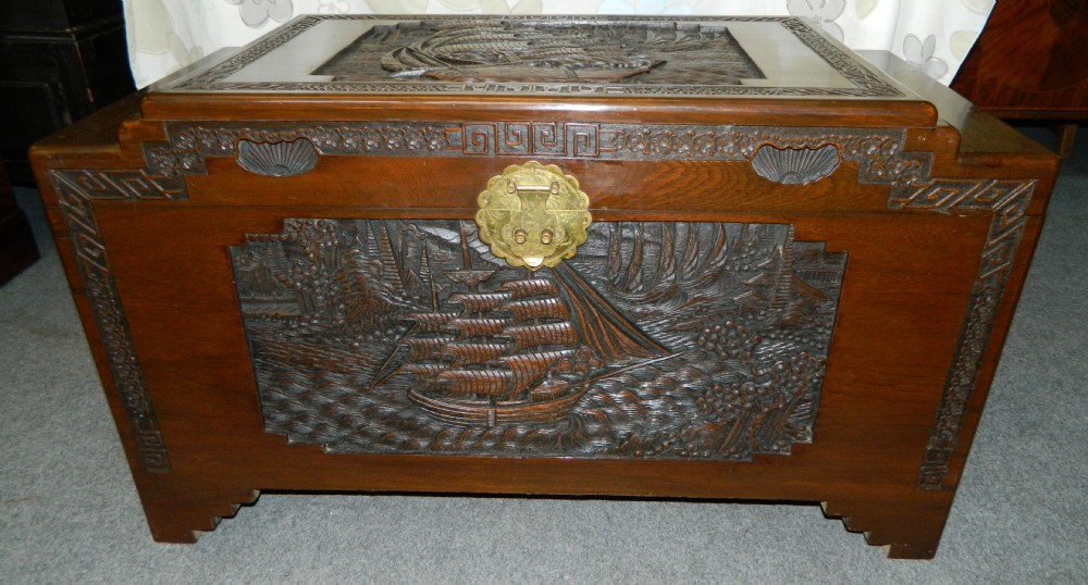 Oriental carved camphor wood trunk