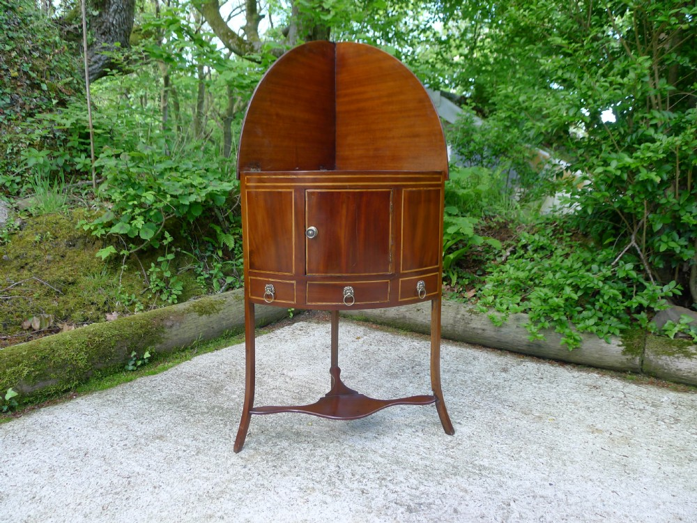 a good georgian bow front mahogany corner display standwash stand with rare fold down top circa 1790