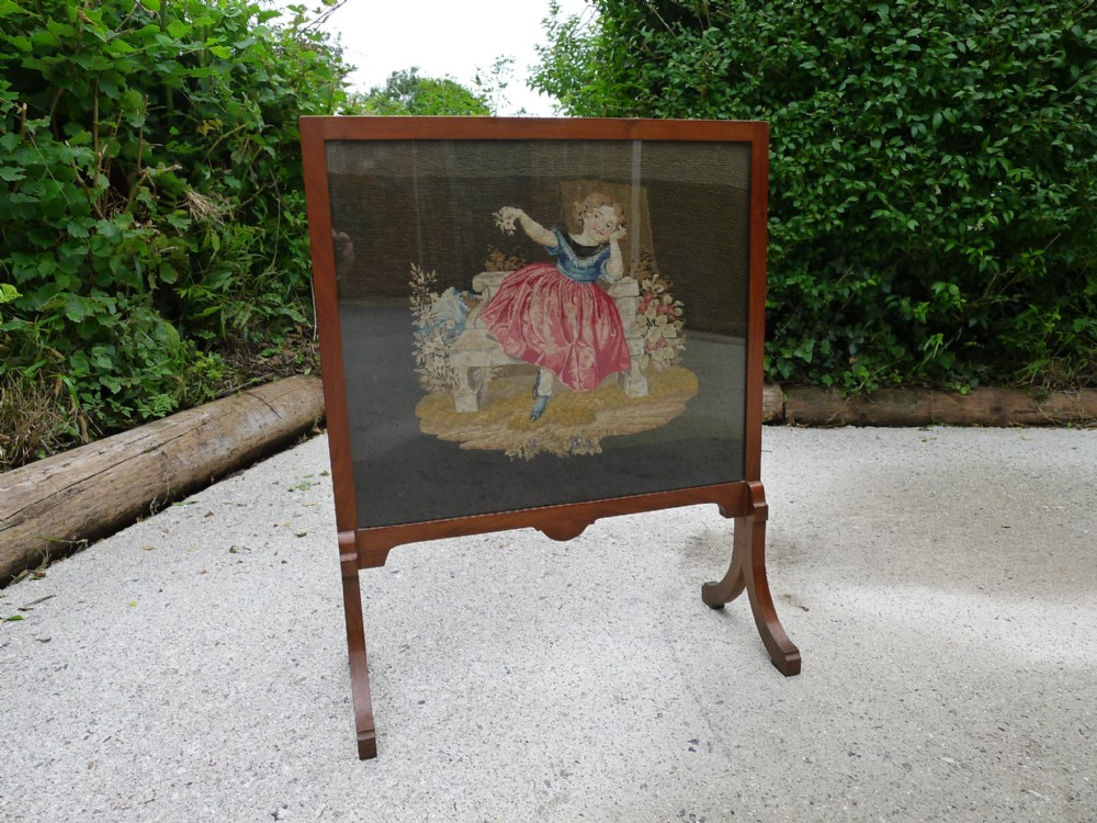 a beautiful petit point embroidered tapestry walnut framed fire screen circa 1880