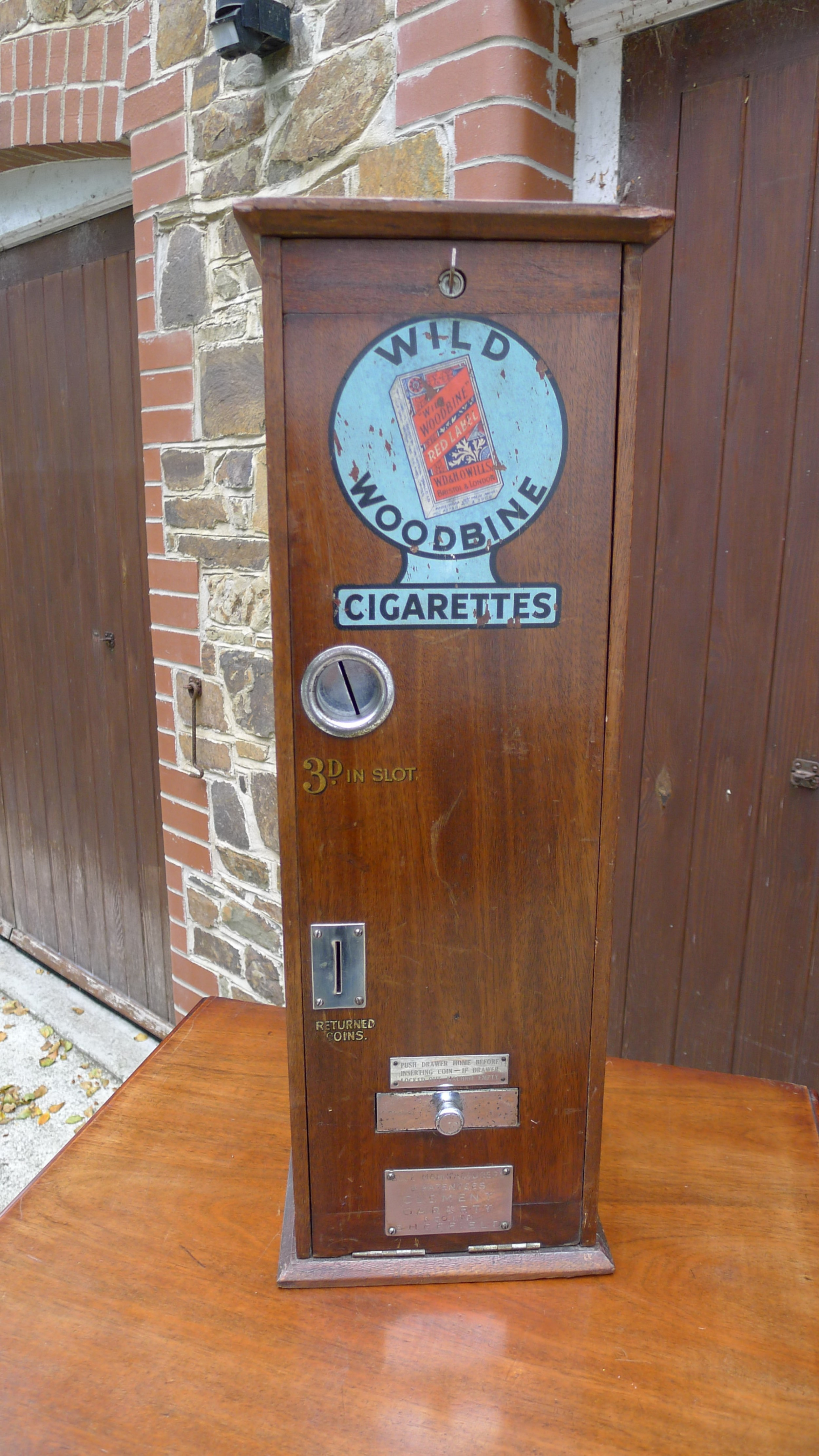 a 'wild woodbine' cigarette vending machine in full working order circa 1930 3d a packet complete with old pennies