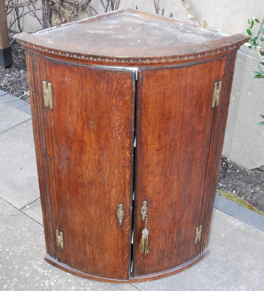 george iii oak bow fronted corner cupboard