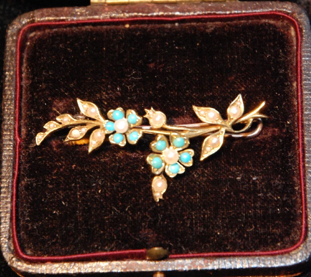 15 ct gold forgetmenot brooch with 10 turquoise and 21 pearls