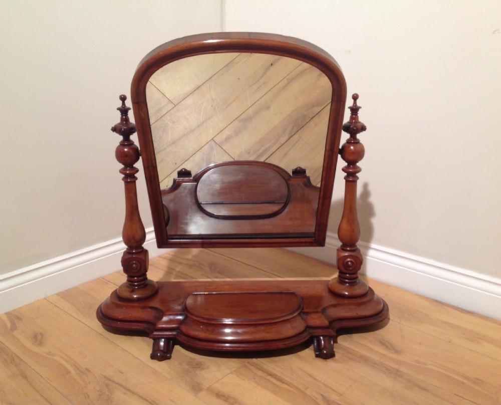 mahogany decorative swing mirror with candle box c1860