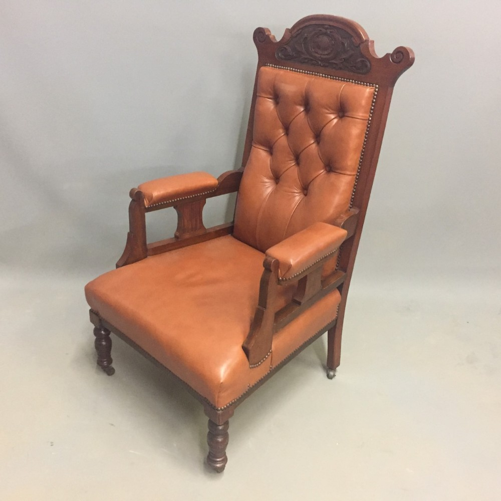 edwardian walnut framed leather open armchair