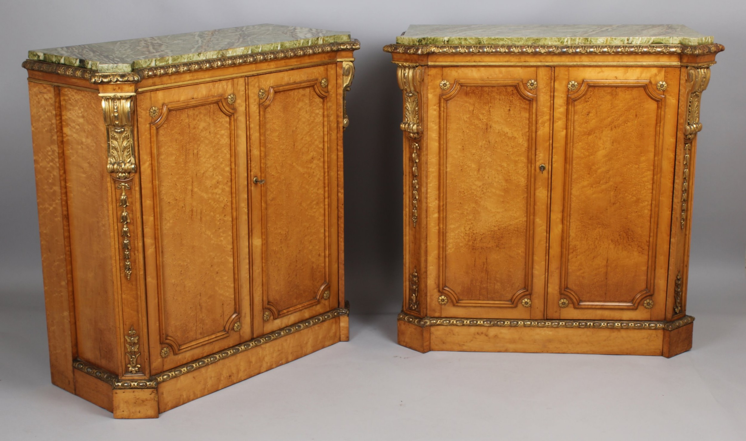 fine pair of midnineteenth century birds'eye maple and parcelgilt sidecabinets