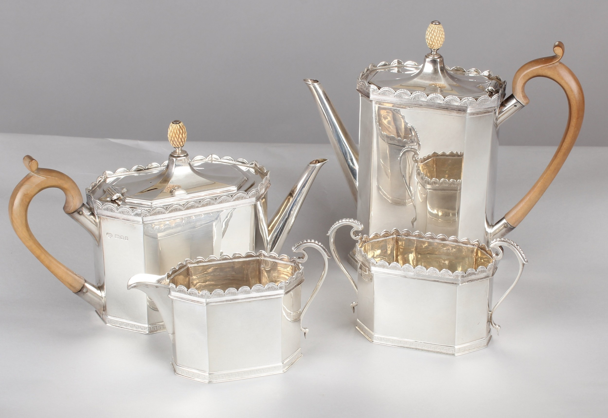 fine quality george v heavygauge silver fourpiece tea and coffee service in the late 18th century style
