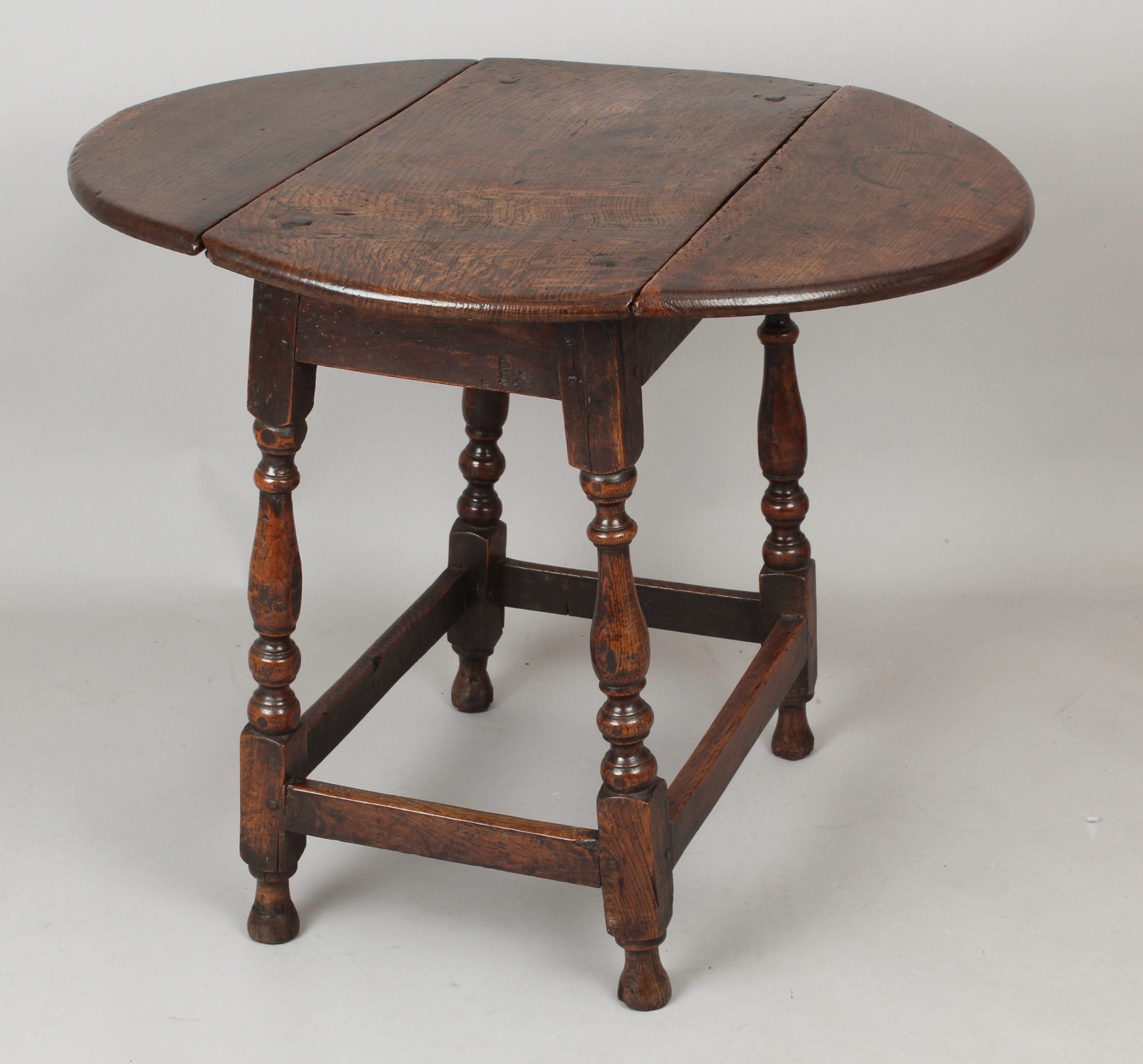 early 18th century oak dropleaf table of small proportions