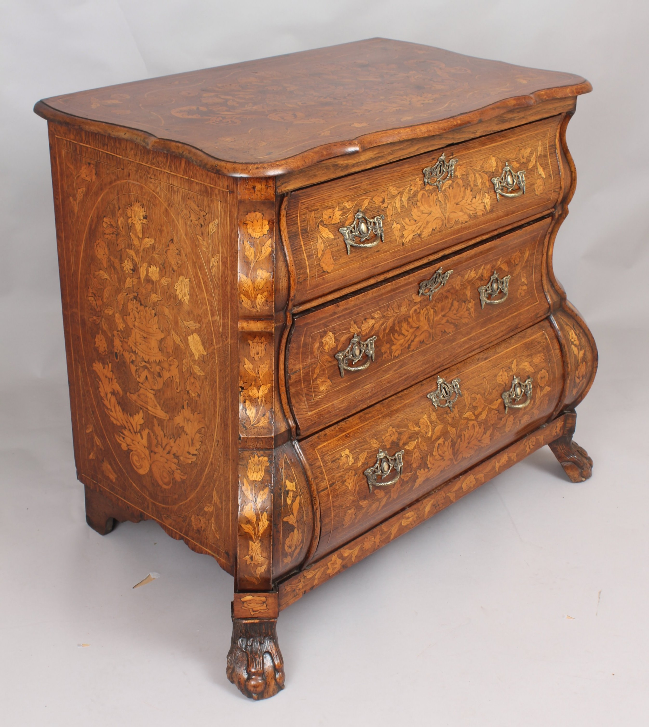 eighteenth century dutch walnut and marquetry chestofdrawers of bold bombe form