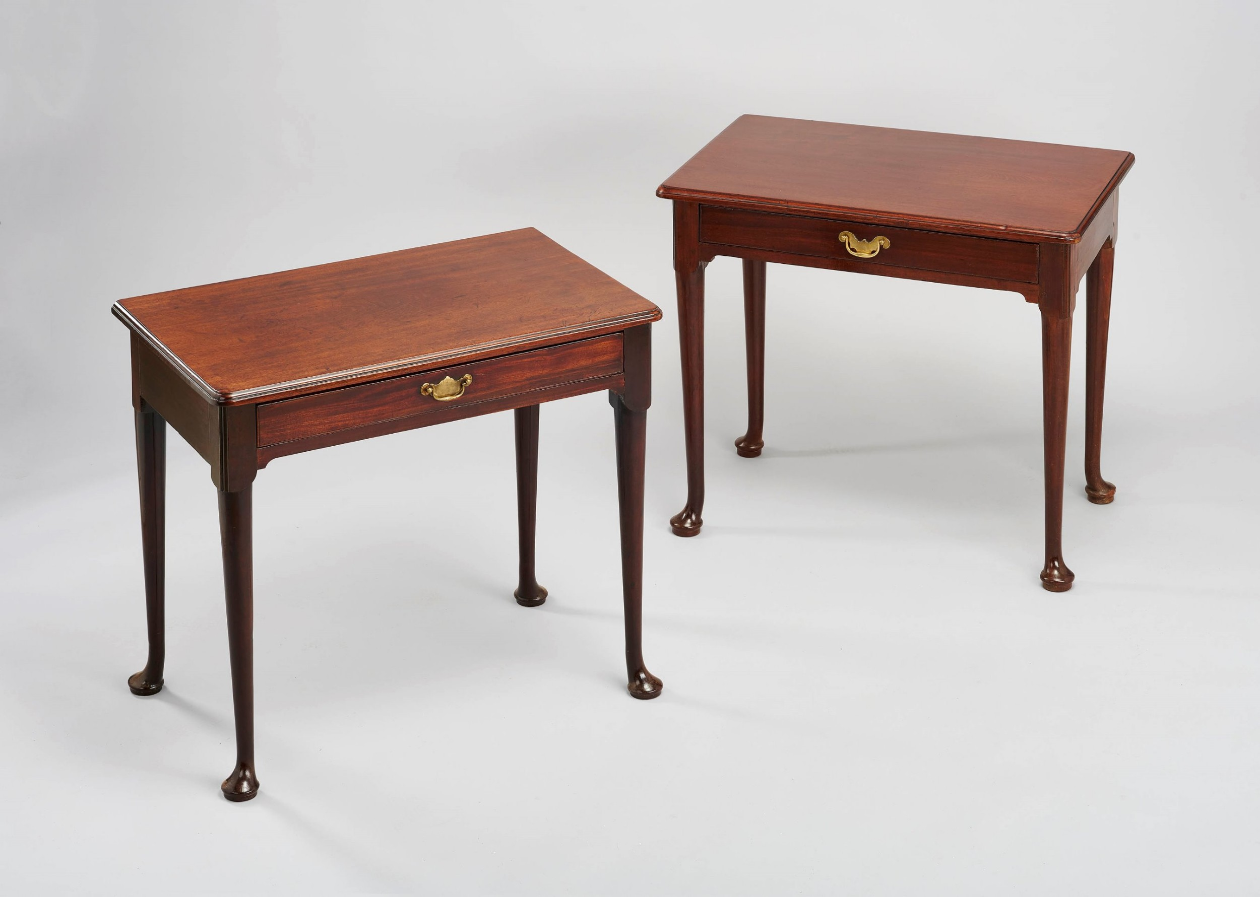 a matched pair of george ii period 'red walnut' sidetables