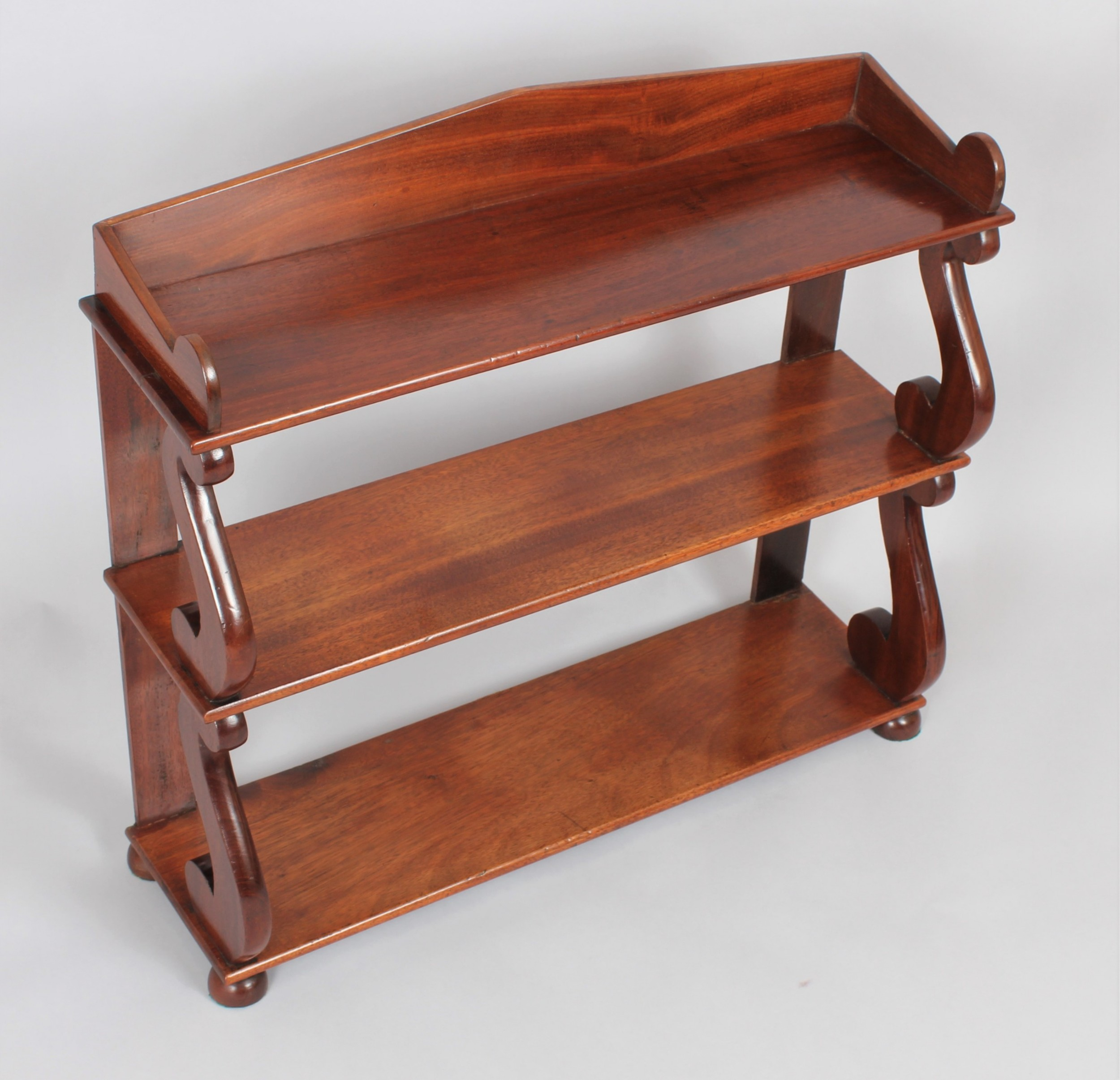 a regency set of mahogany hanging shelves