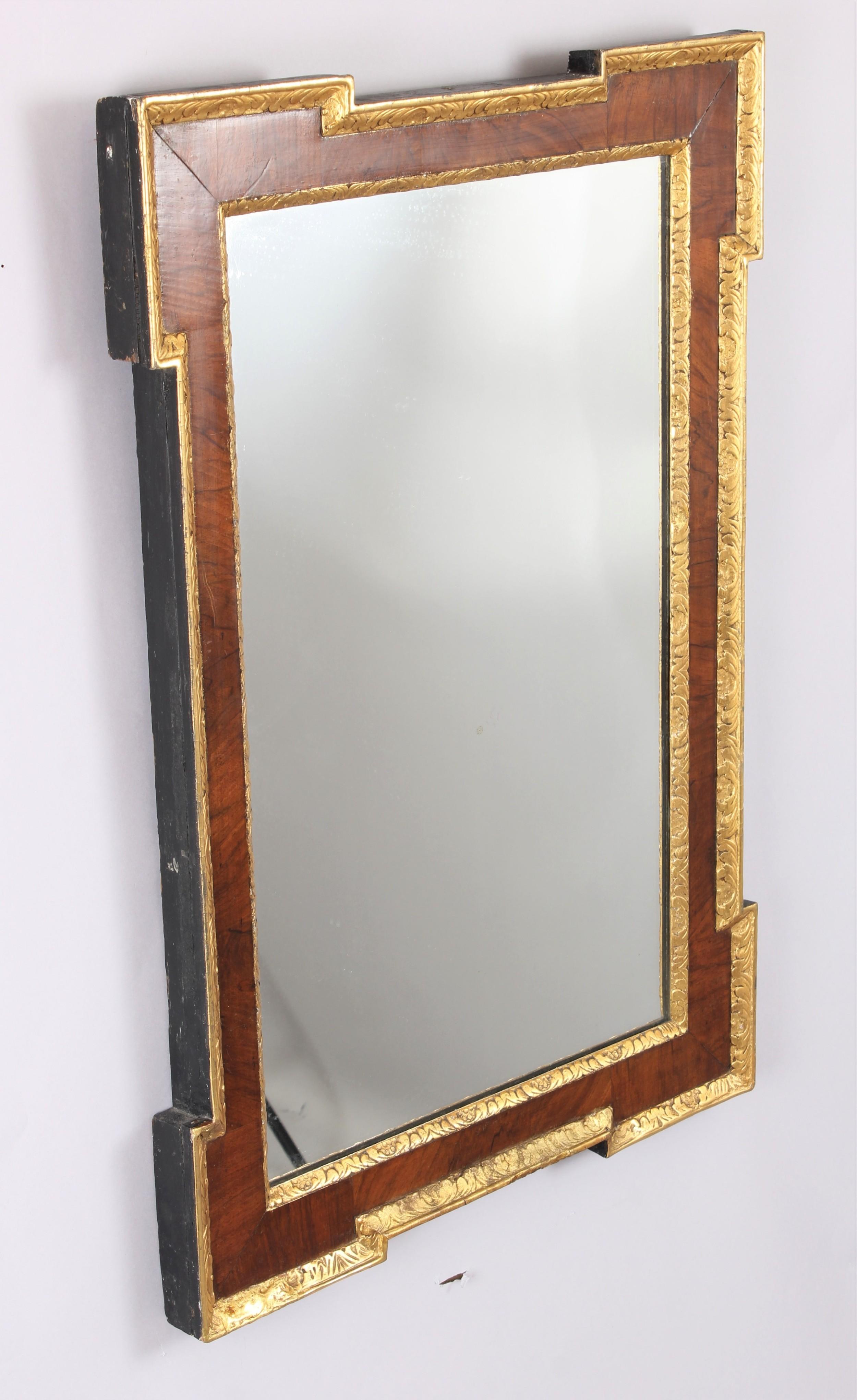 an 18th century walnut and gilt slip rectangular mirror
