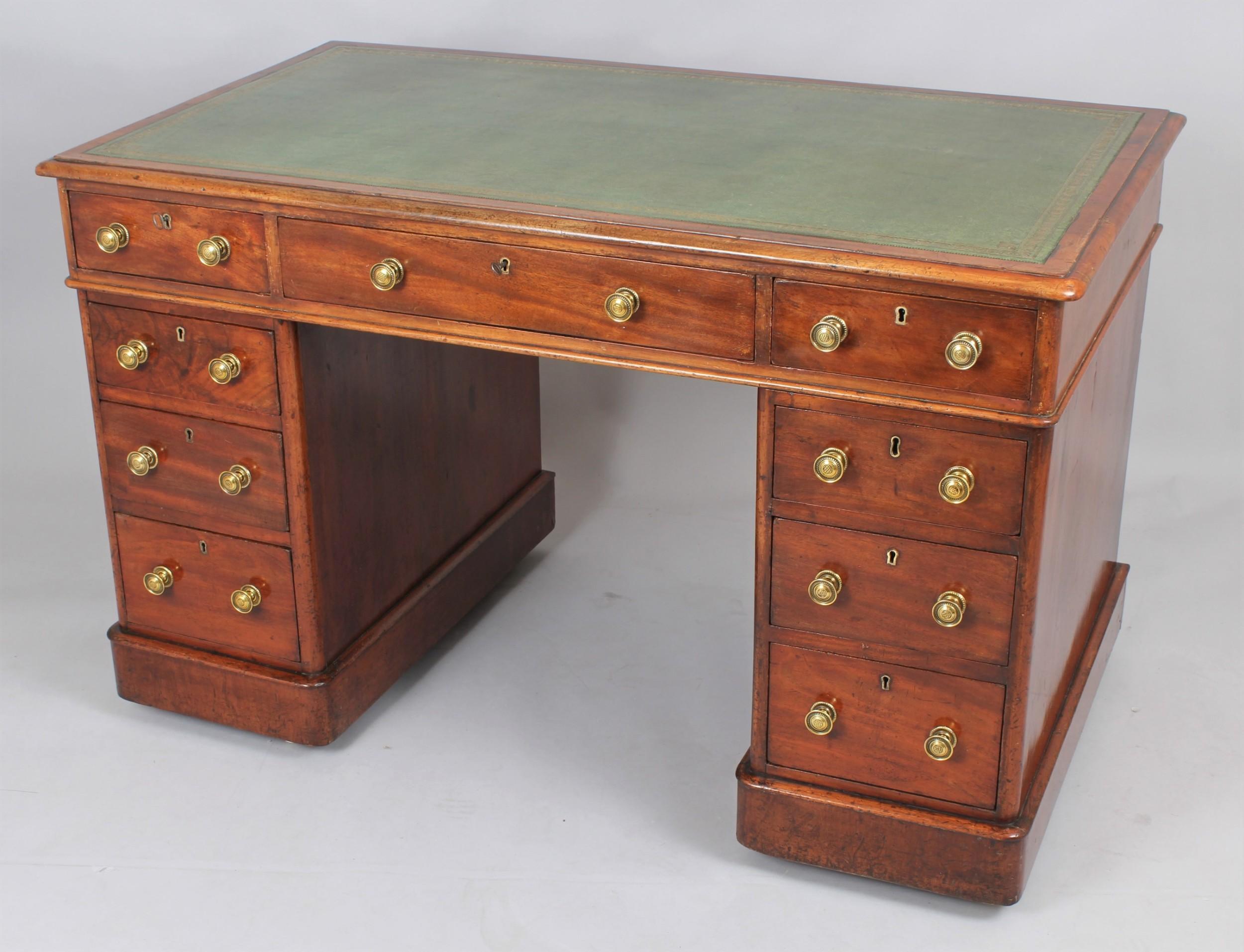 a mahogany threepart pedestal desk