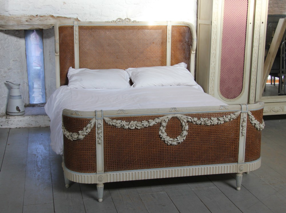 beautiful and original french painted and caned king size bed