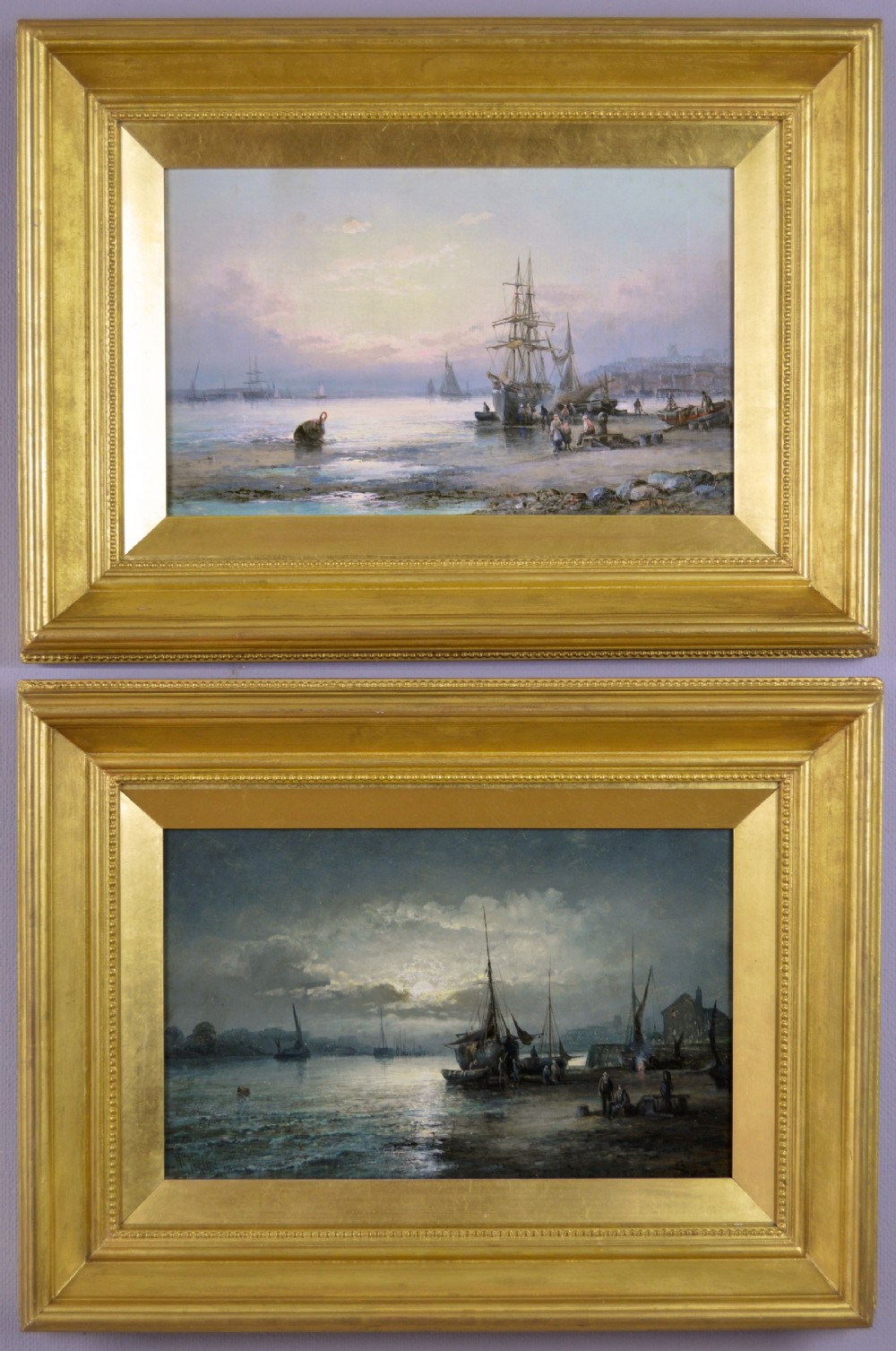 pair of seascape oil paintings of fishing boats off a shore by william anson thornberry