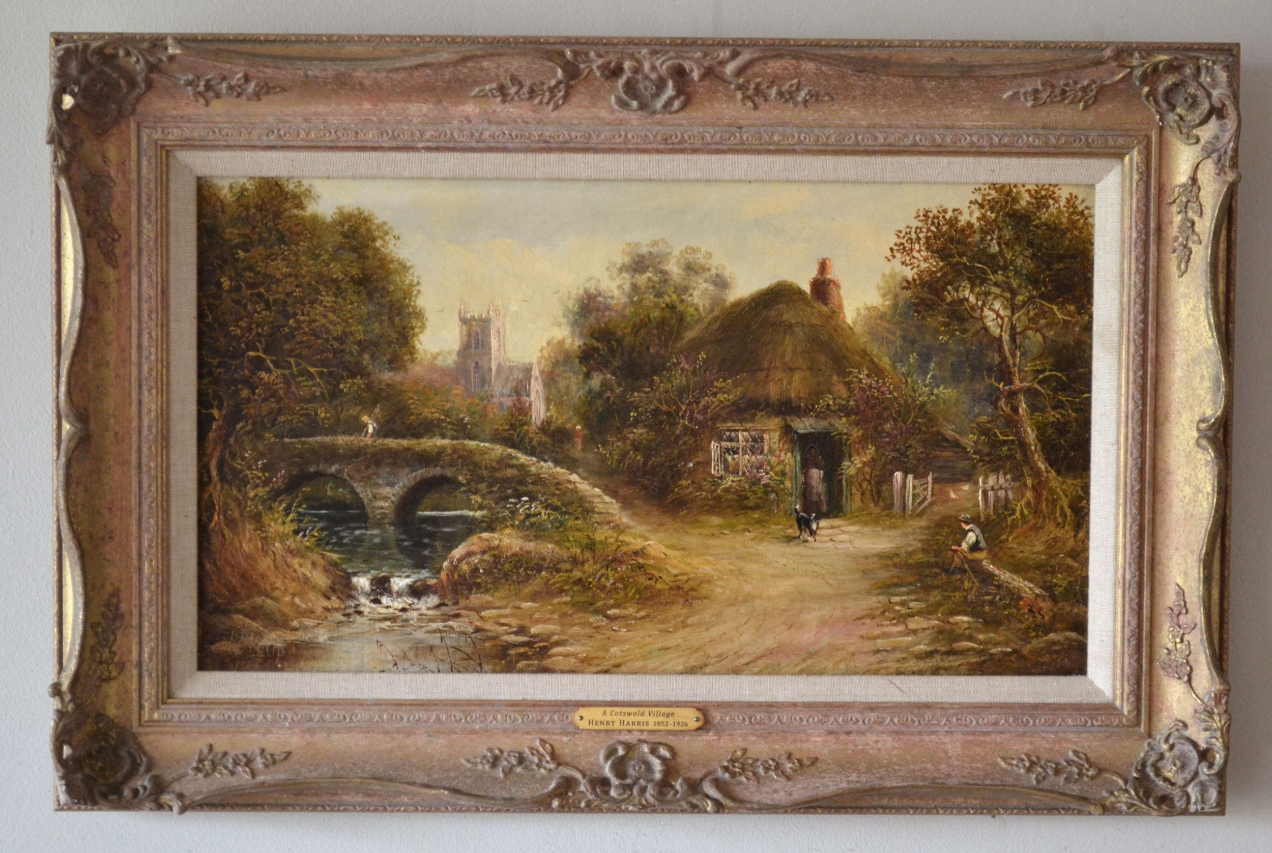 a cotswold village c1900 oil on canvas henry clarence harris 18521926