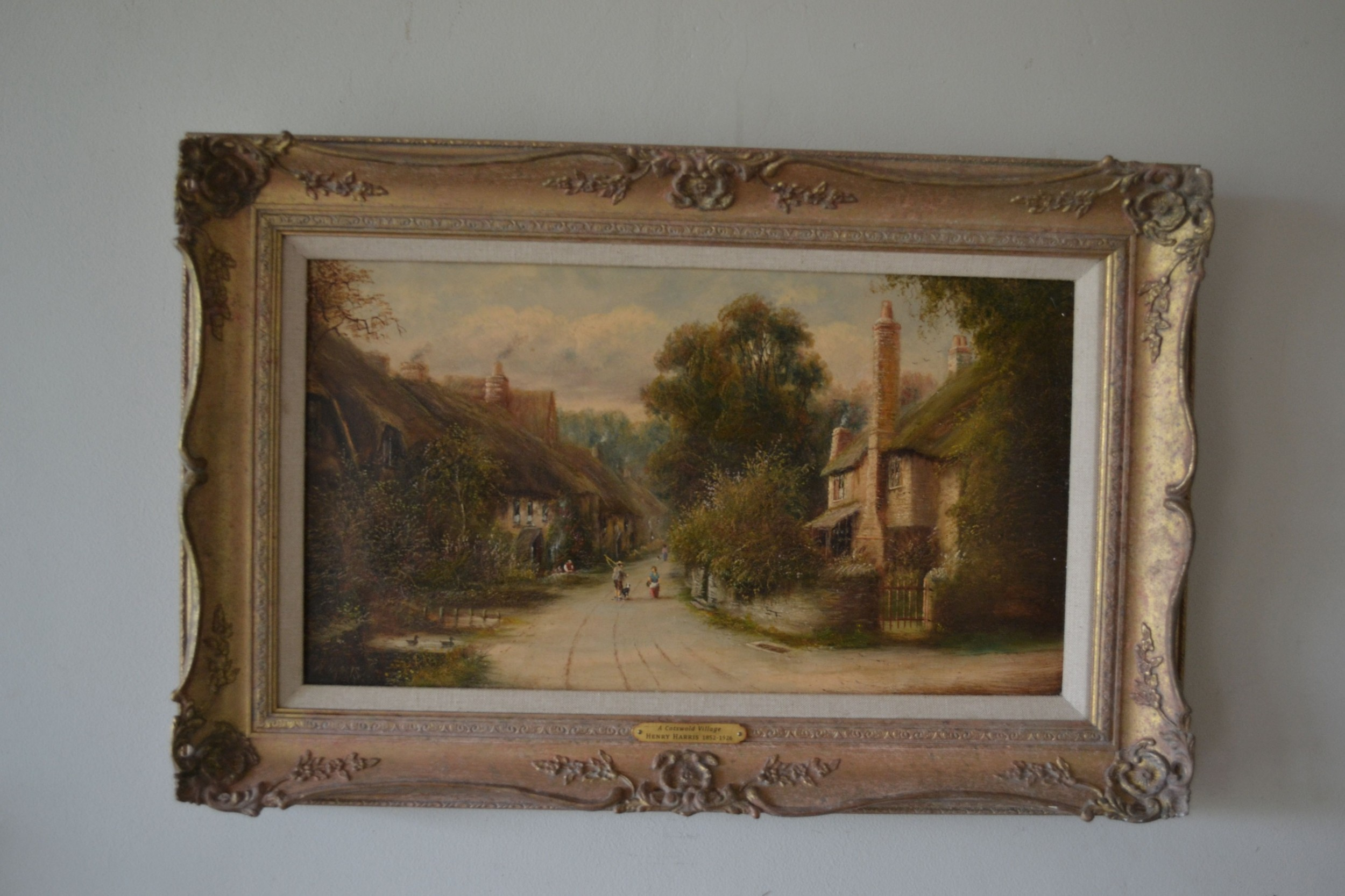 cotswold village c1900 oil on canvas english landscape henry clarence harris 18521926