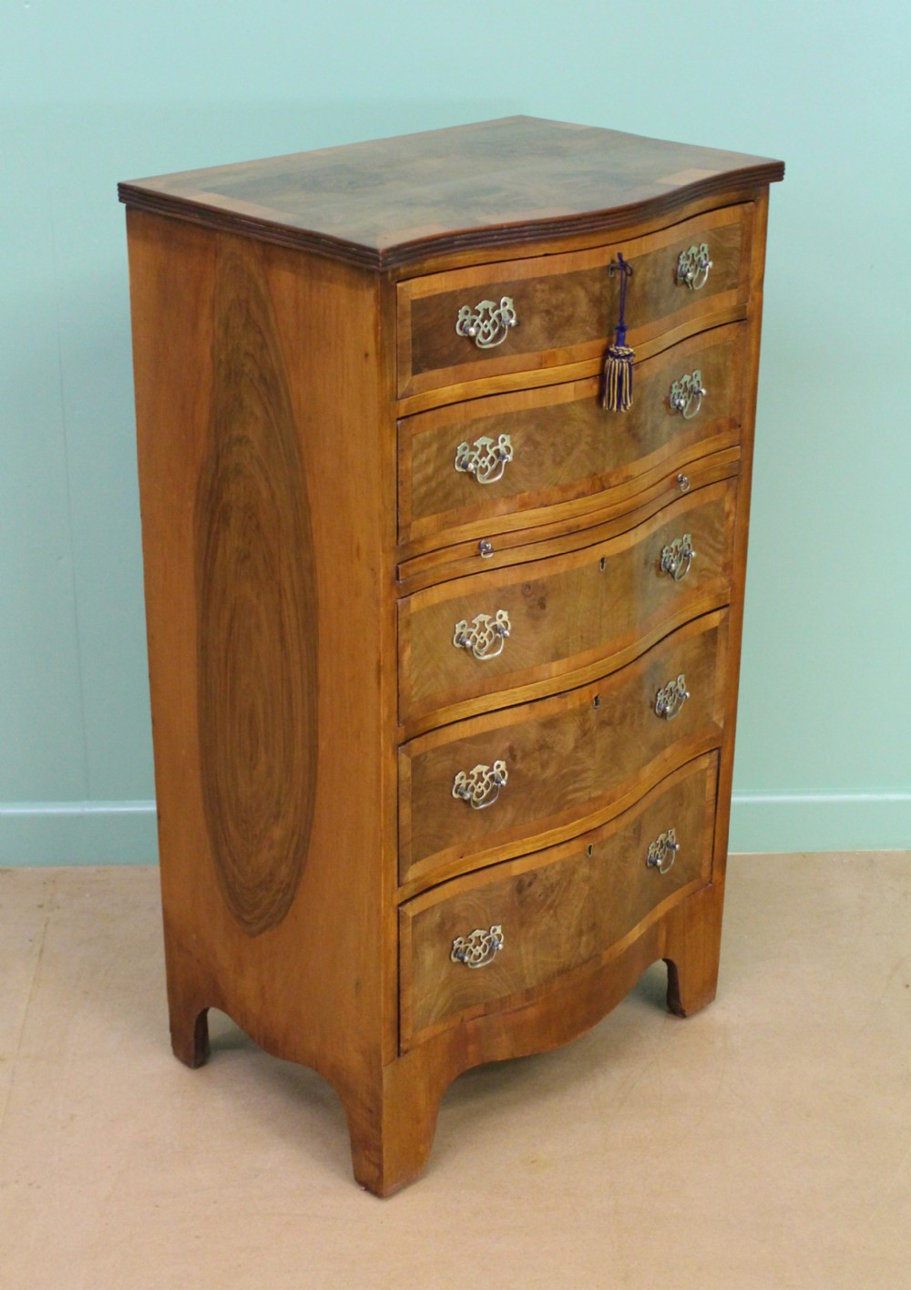 burr walnut serpentine chest of drawers