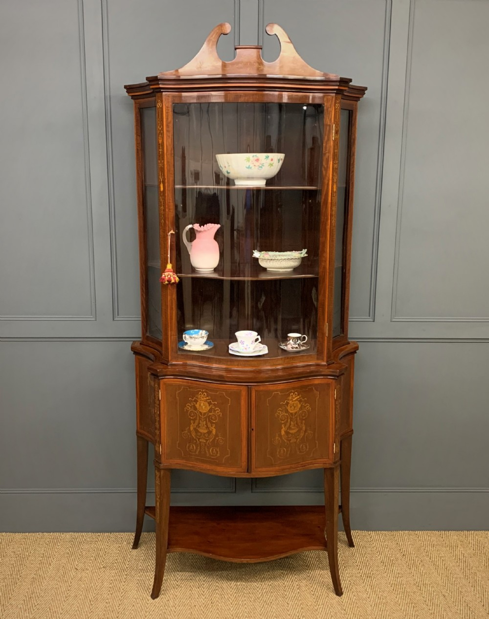 edwards and roberts serpentine display cabinet