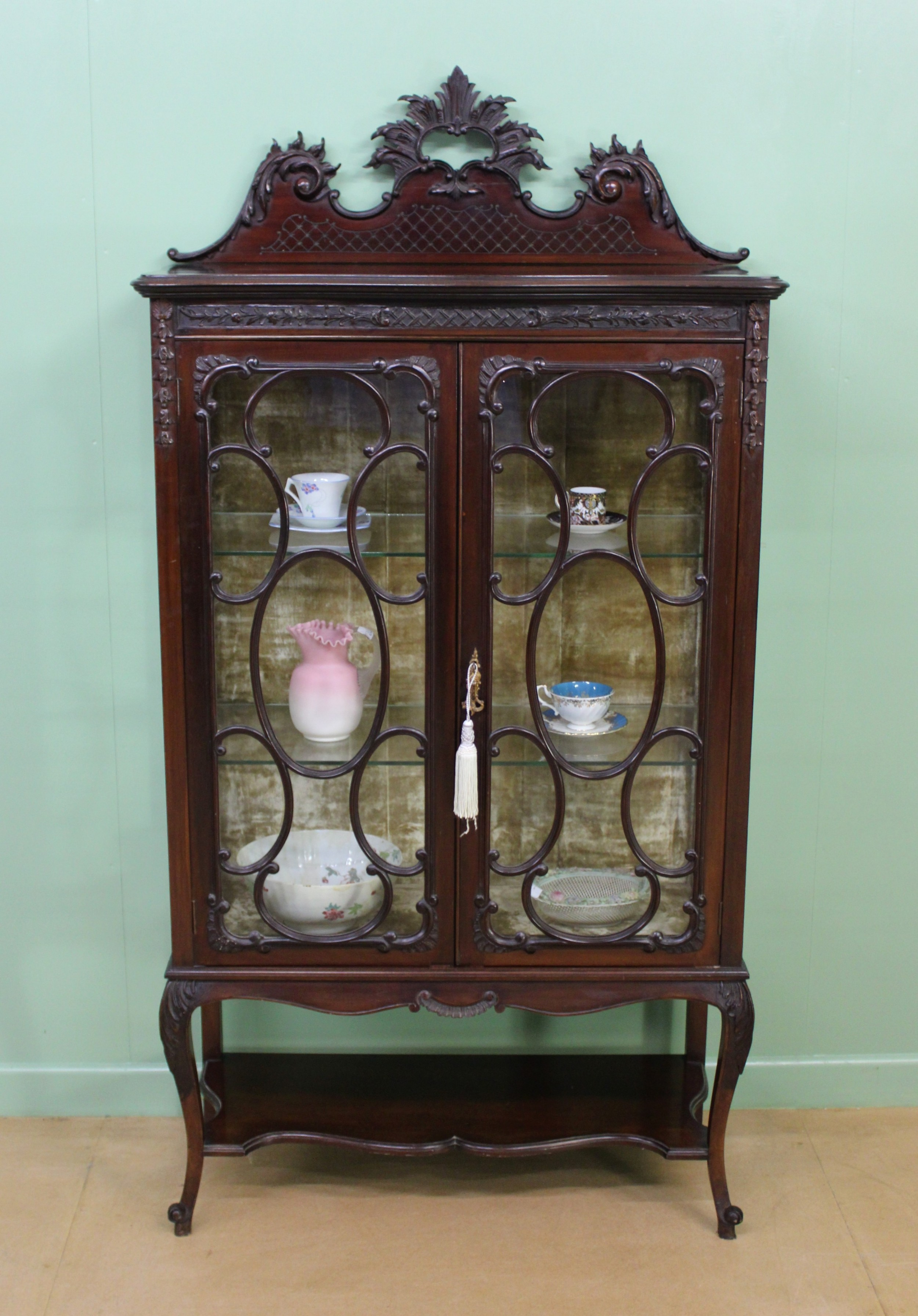 maple and co carved mahogany display cabinet