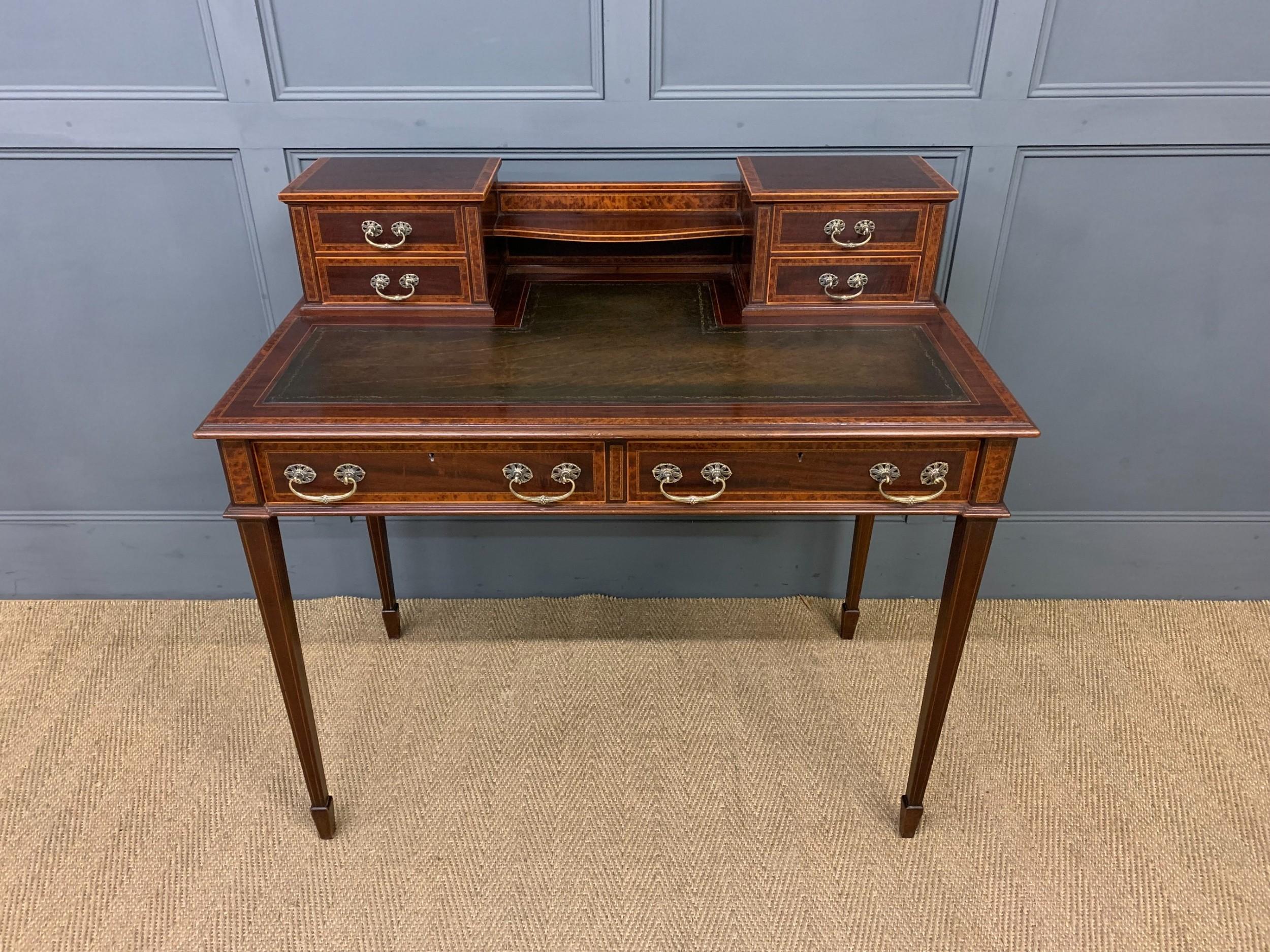 inlaid mahogany and amboyna writing desk