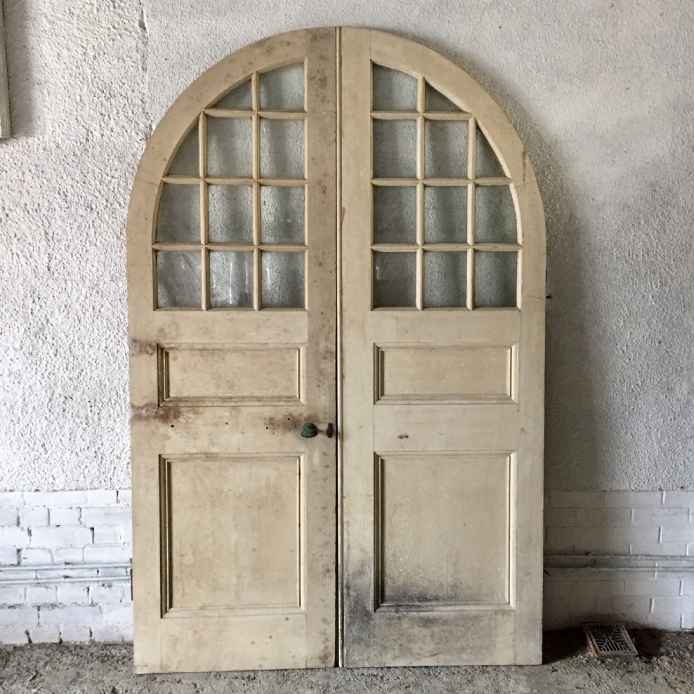 pair of victorian pine arched top doors complete with brass furniture and key