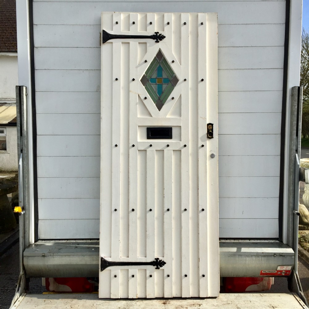 1920s external pine painted door with faux strap hinges and lead light lozenge shape panel