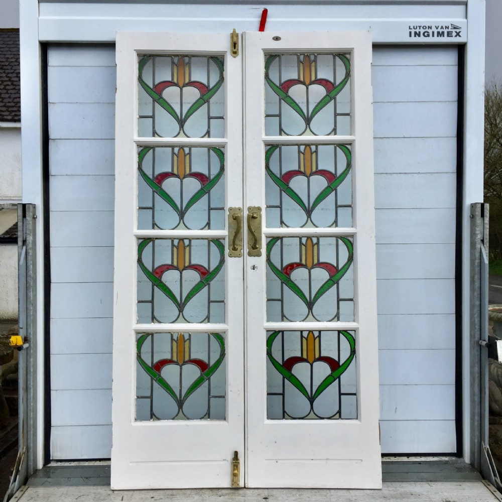 pair of 1920's french doors with art nouveau lead light panels and brass handles