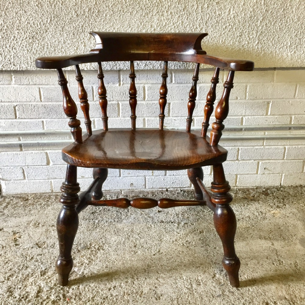 19th century beech smoker's bow arm chair with an unusual large elm seat