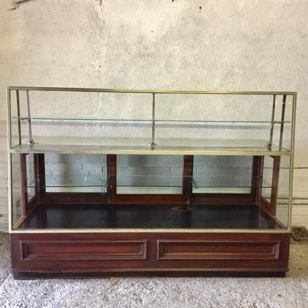 circa 1910 shop display cabinet with marble top on mahogany frame