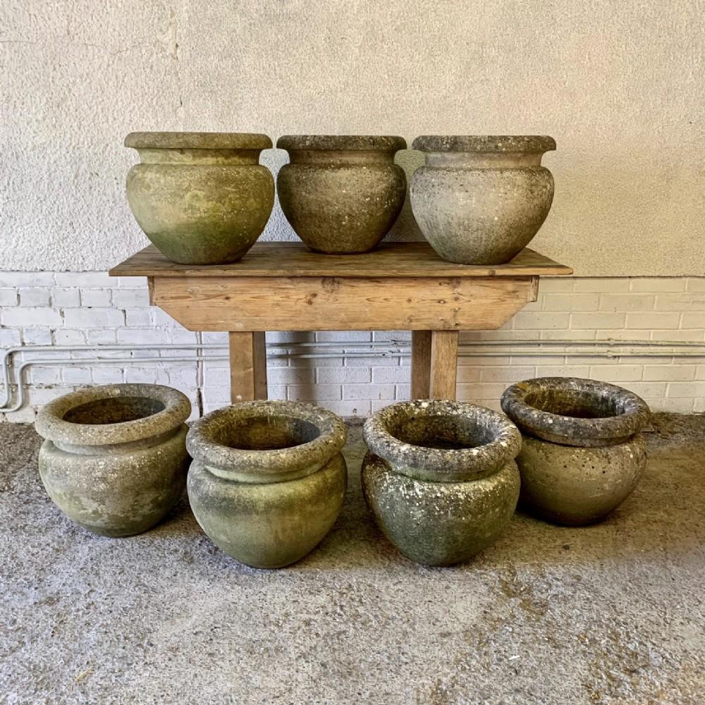 set of 7 circa 1920 composition stone pots
