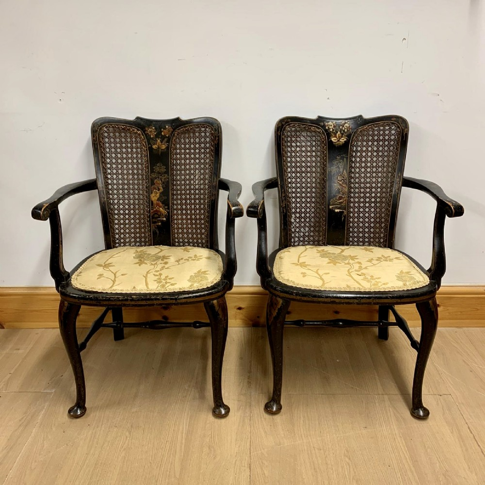a pair of english chinoiserie and japanned lacquered arm chairs