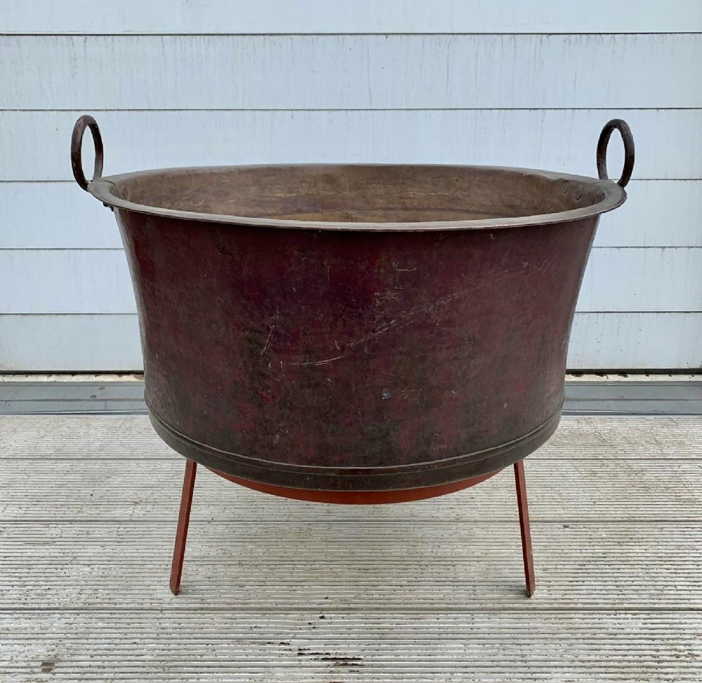 19th century cauldron on associated stand