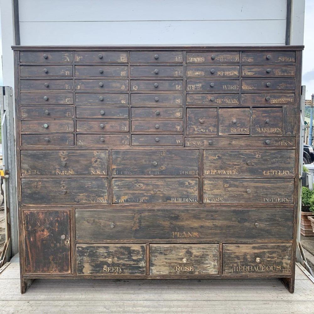 19th century pine bank of 43 drawers and 1 cupboard in original finish