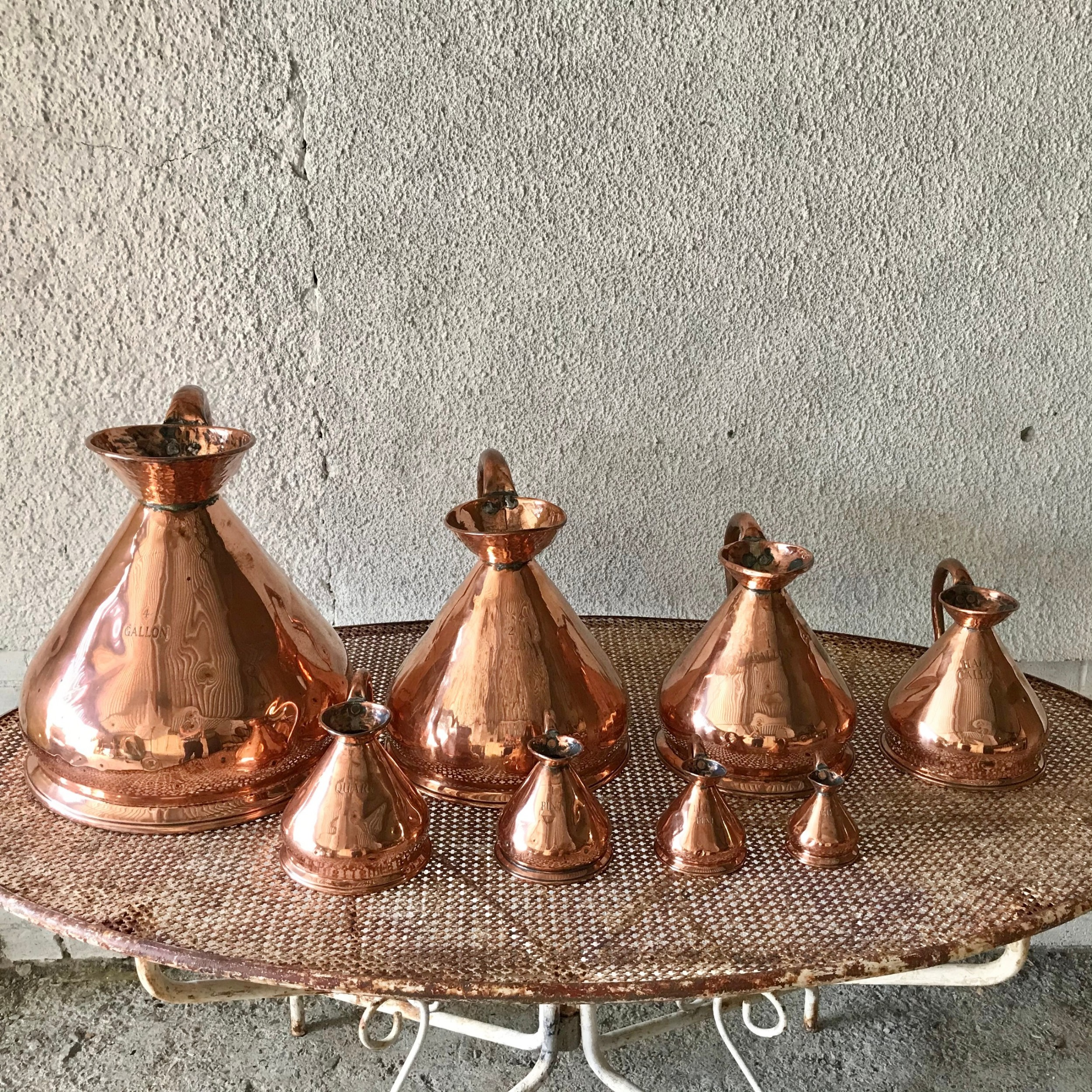very rare harlequin set of 8 victorian copper measures