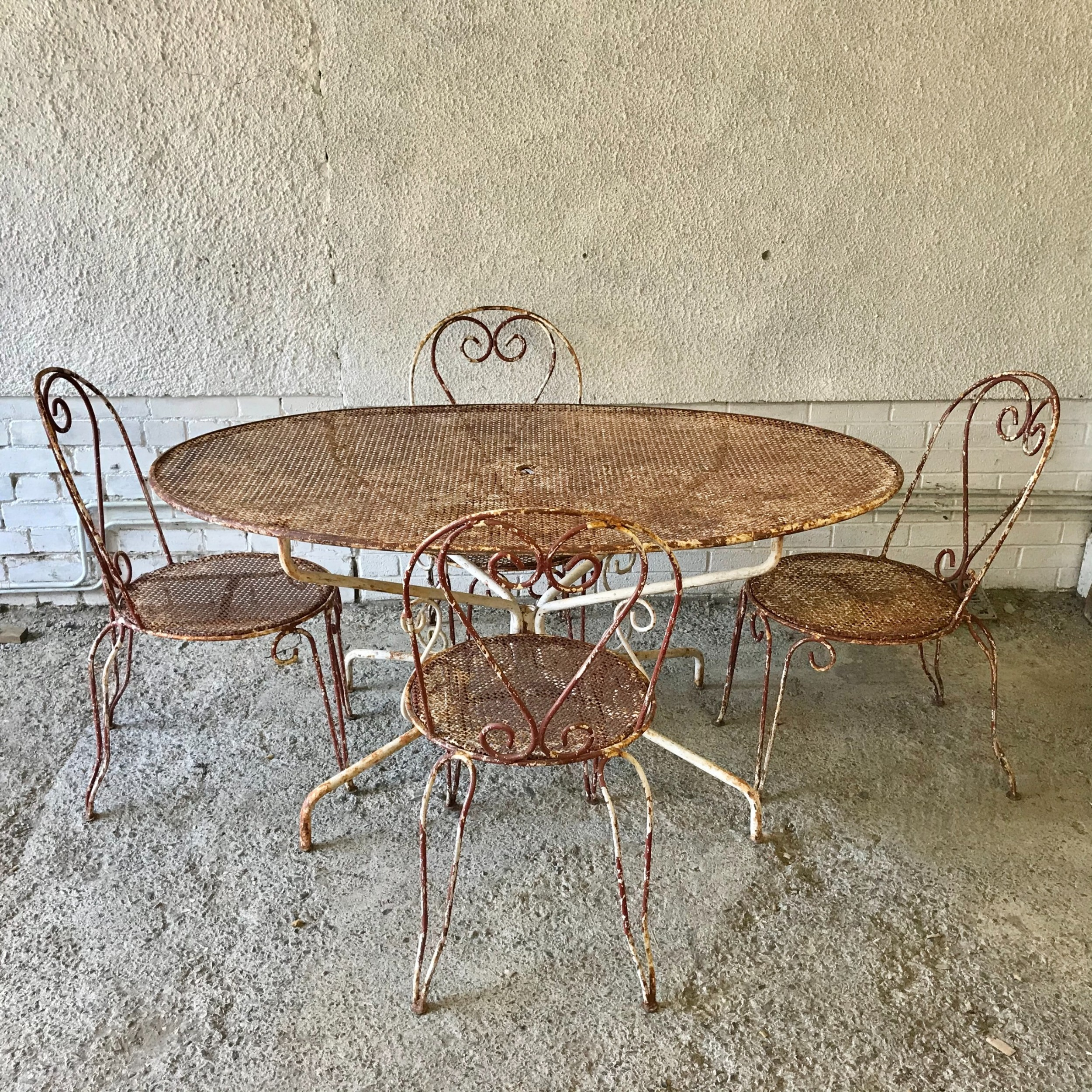 1920's 30's french cafe garden table with pierced metal top and 4 chairs with pierced seats