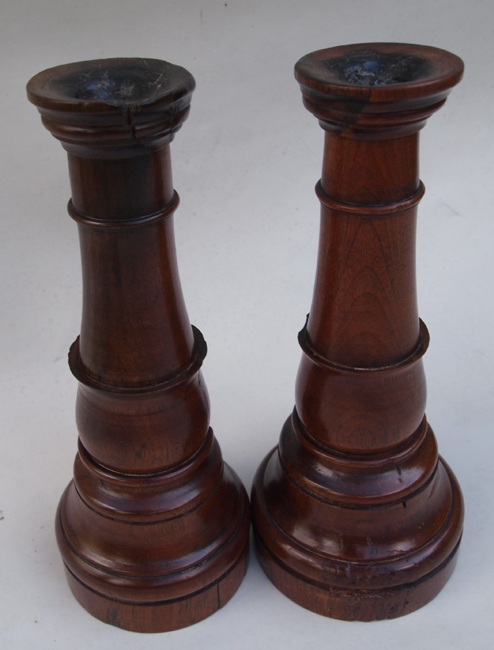 pair early 19th c fruit wood candle sticks