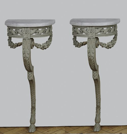 a pair of 19th century french painted console tables with carrara marble tops