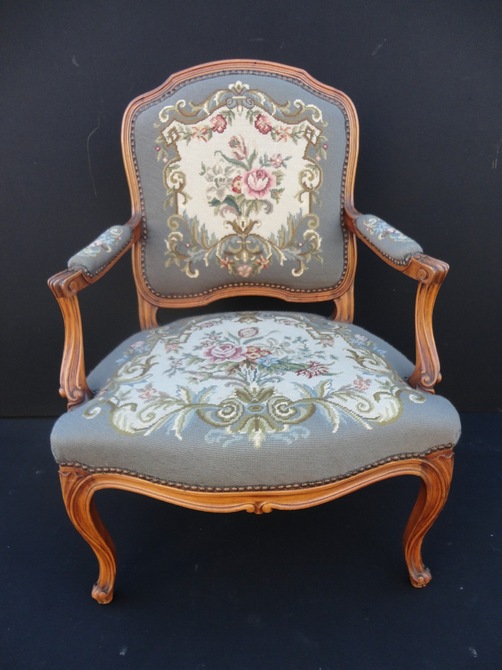 French Carved Walnut Armchair With Tapestry Upholstery