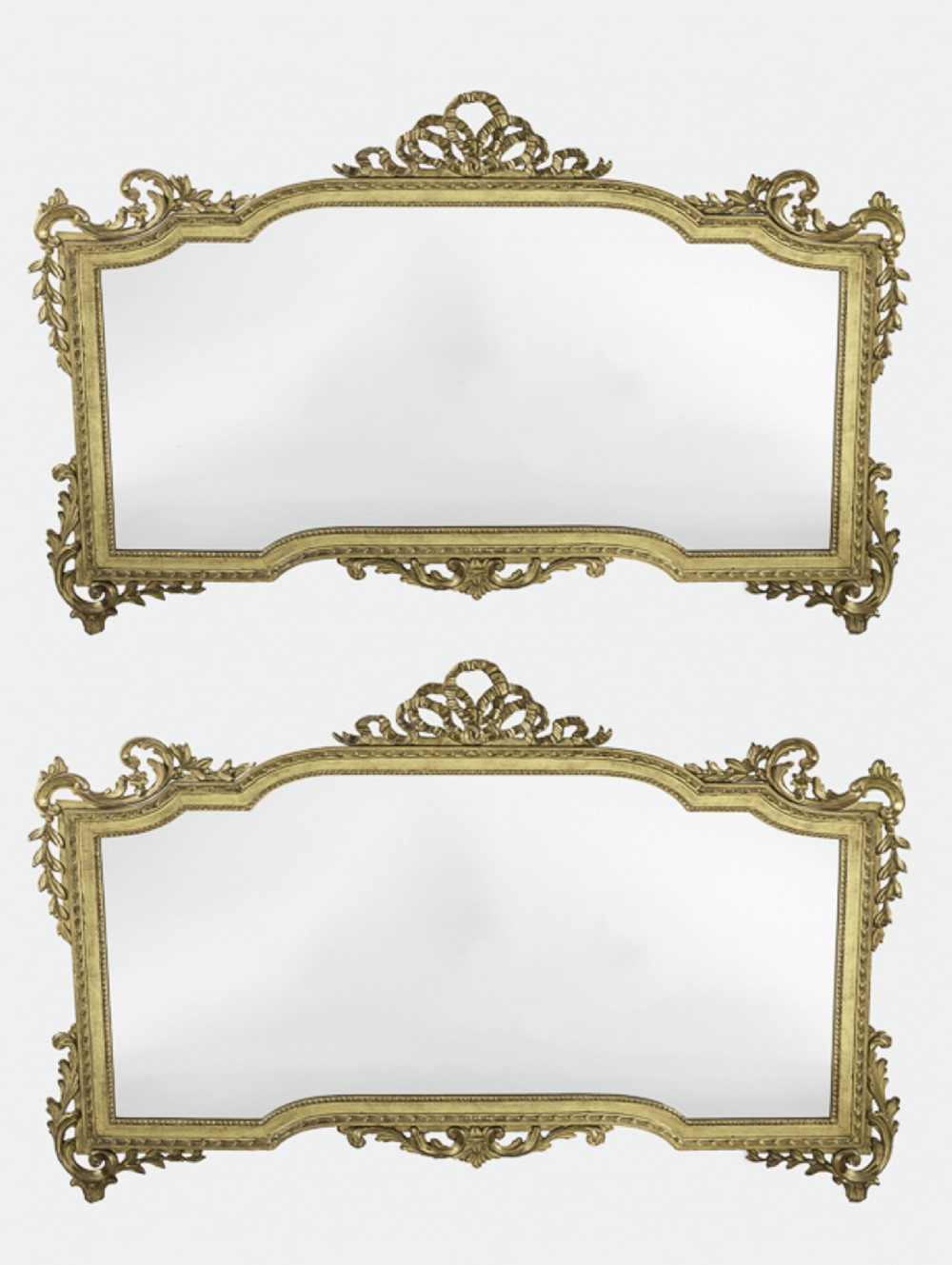 pair of english large gilt overmantle mirrors