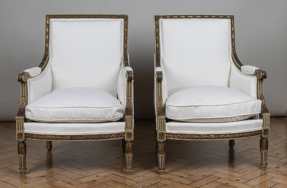 pair of 19th century french large painted and gilt armchairs