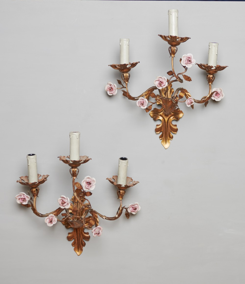 a pair of french gilt metal wall sconces