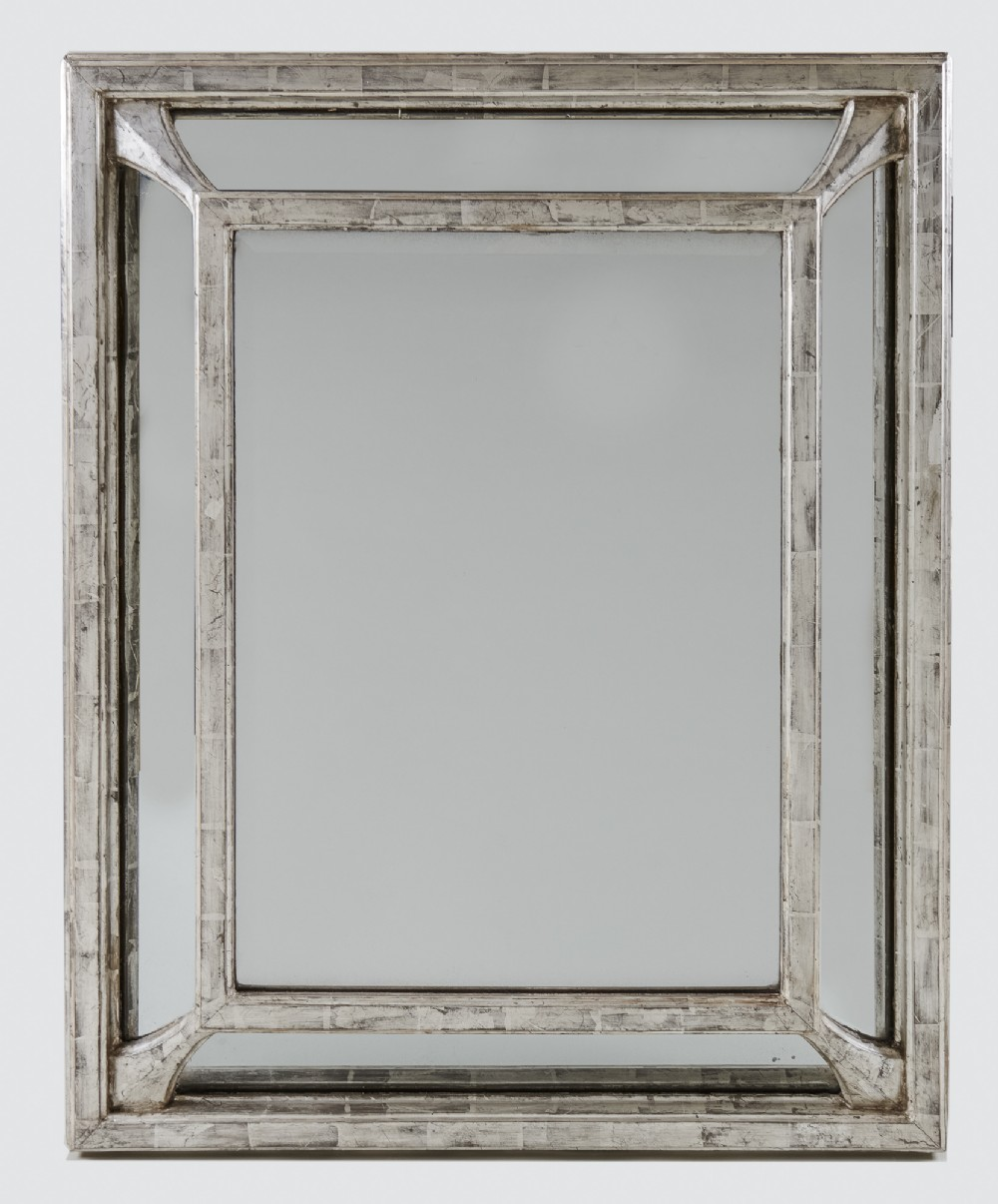 a 19th century large french silvered cushion overmantle mirror