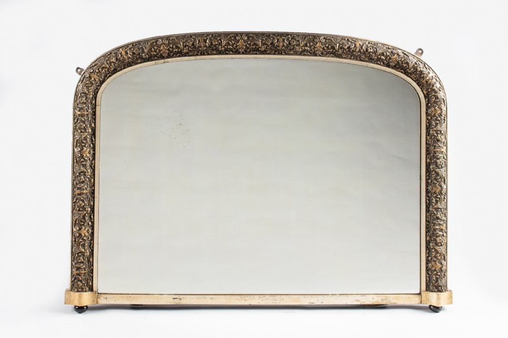 a 19th century english victorian silvered gilt overmantle mirror