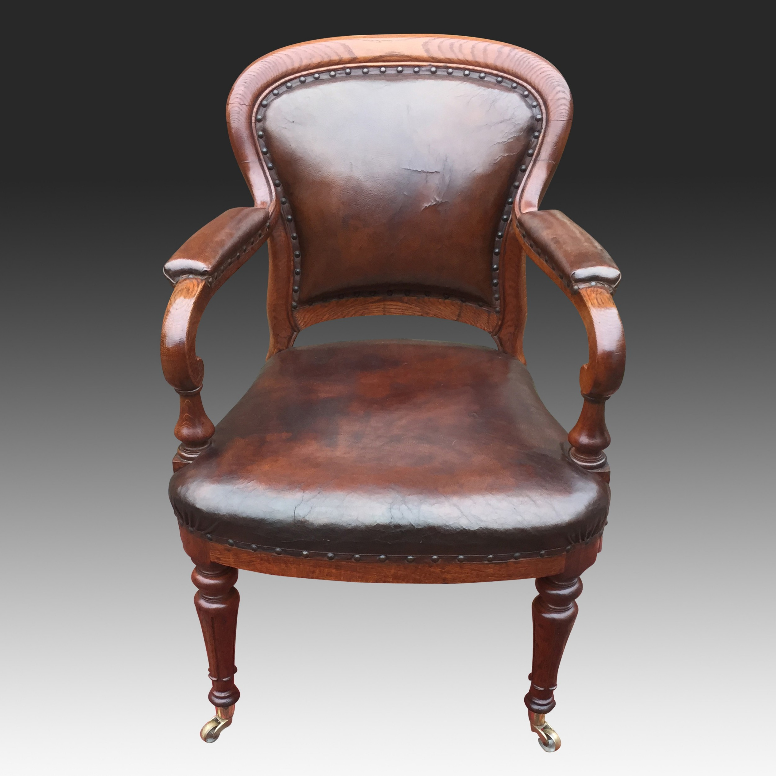 antique oak and leather desk armchair by gillow circa 1840