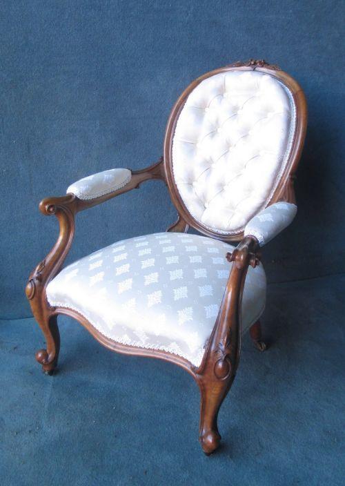 an oval walnut buttoned back armchair