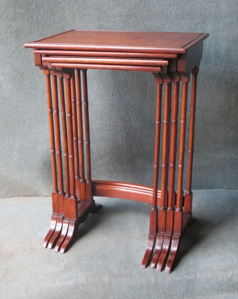 an edwardian nest of mahogany tables