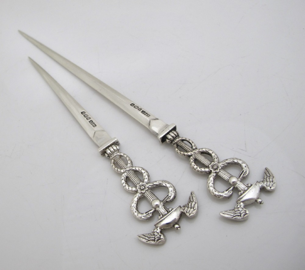 rare graduated pair of silver cauduceus poultry skewers james dixon sons sheffield 1898